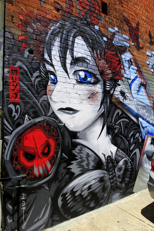Graffiti della ragazza osservati blu fotografia stock libera da diritti