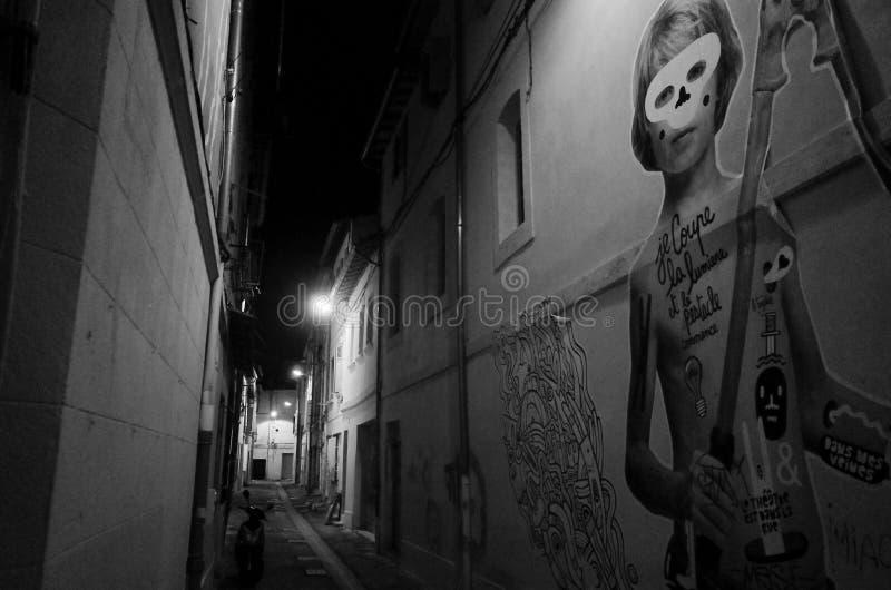 Graffiti in Avignon narrow street royalty free stock images