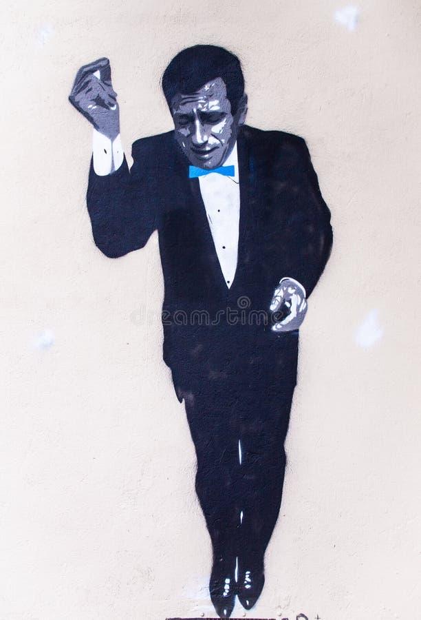Graffiti eines Mannes mit schwarzem Kleid lizenzfreie stockfotos