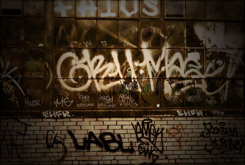 Graffiti Grunge Backsteinmauer-Hintergrund-Beschaffenheit lizenzfreie stockfotografie