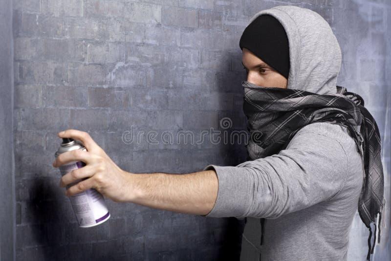 Graffiti guy in action stock photos