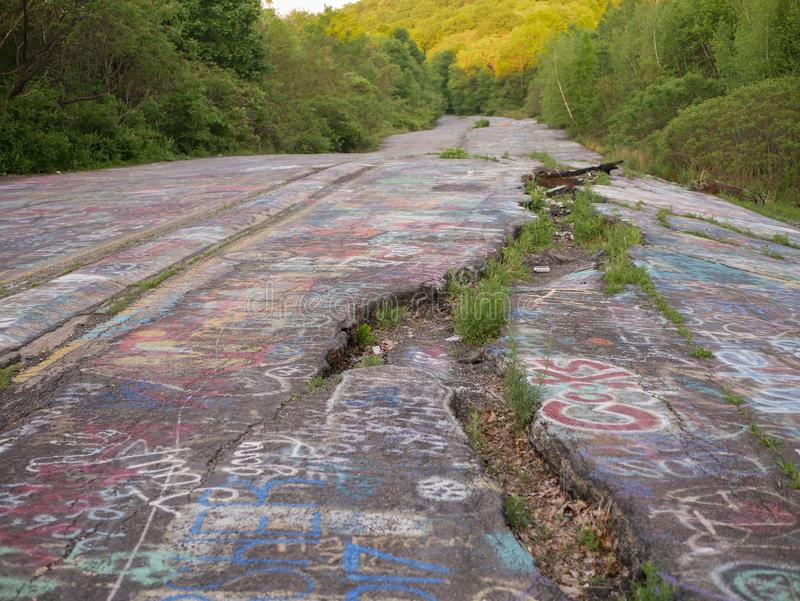 Graffiti Highway. PA-61 Abandoned section of the highway through Centralia stock image
