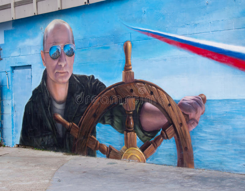 Graffiti with the image of President Putin of Russia on the wall of the seaport city of Yalta, Crimea stock photo