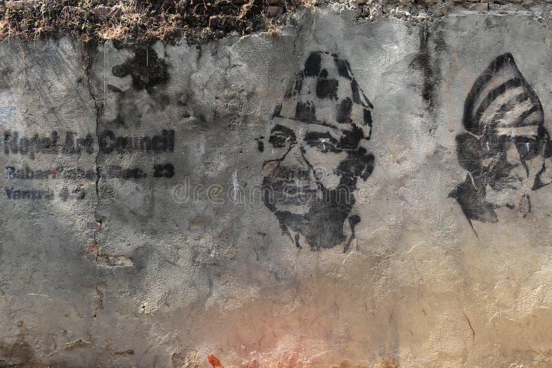 Graffiti in Kathmandu on an uneven cement wall stock photography