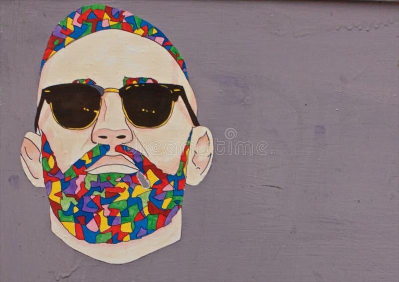 Graffiti of man on wall stock image