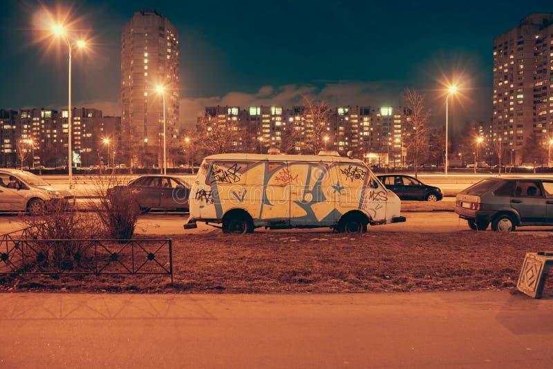 Graffiti on one of the white van. royalty free stock photo