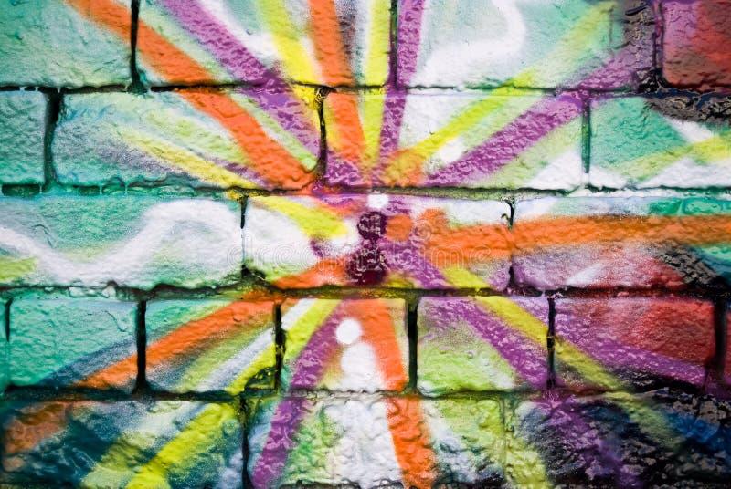 Graffiti op de geweven bakstenen muur stock afbeeldingen
