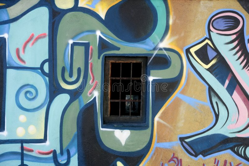 Graffiti over an old village house wall in Spain royalty free stock photo