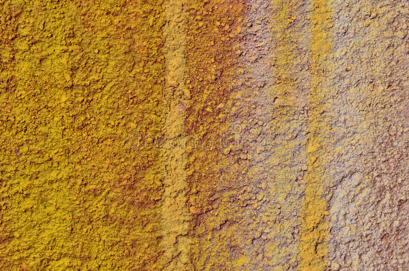 Graffiti paint background. Rough bumpy plastered wall airbrushed with yellow and beige paint royalty free stock photo