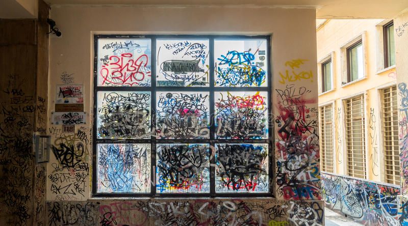 Graffiti painted illegally on public wall in Potenza, Italy. POTENZA, ITALY - MARCH 13, 2015: vandalized urban wall with tags and graffiti in Potenza, Italy stock images