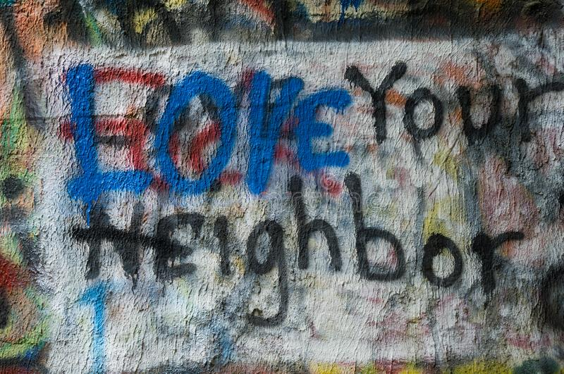 Graffiti painted on a wall with a message of LOVE stock image