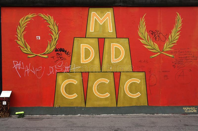 A Graffiti Painting On The East Side Gallery Wall In Berlin, Germany ...