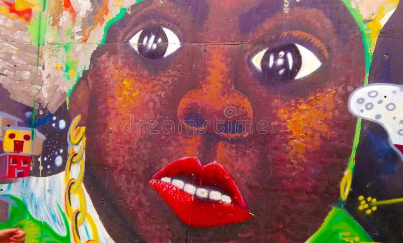 Graffiti. The photograph shows a graffiti that has a face of an African-American person royalty free stock image