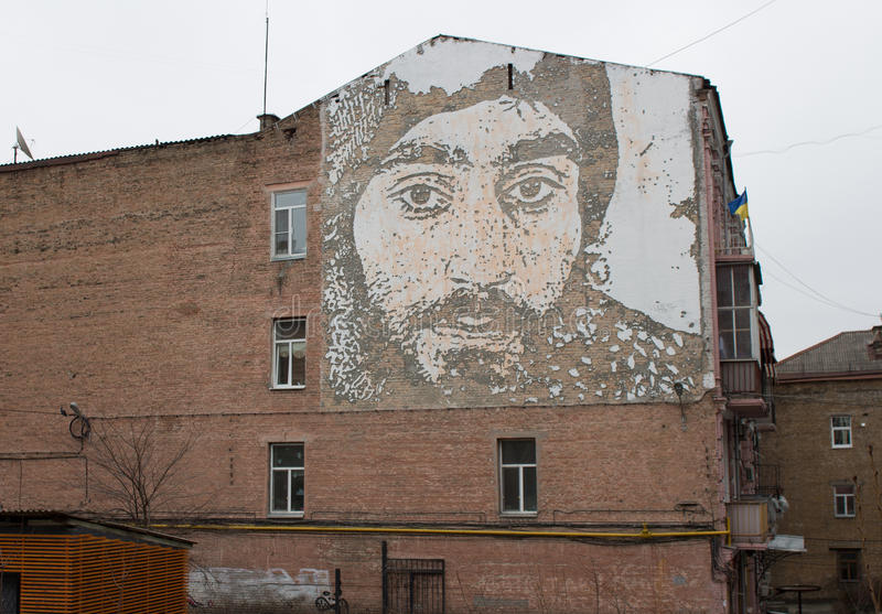 Graffiti. Portrait of a hero Sergei Nigoyan euromaidan painted on one of the buildings in the center of Kiev. In the house next to the Square of Heavenly stock photo