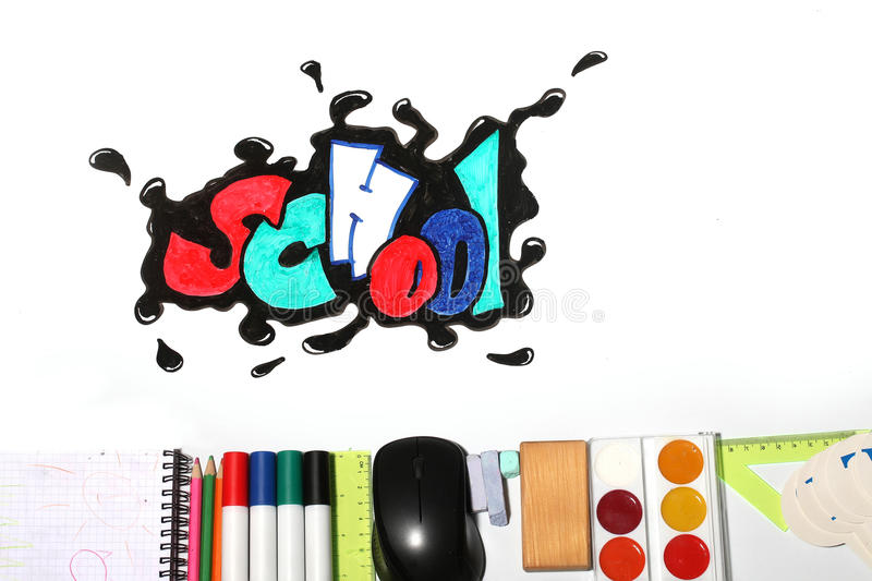 Graffiti school word and supplies. School text word painted graffiti with smiley eyes on paper near pencils markers computer mouse chalk ruler paint palette royalty free stock image