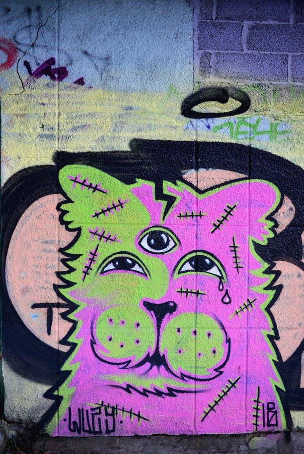 Graffiti street art with a sad dog stock photos