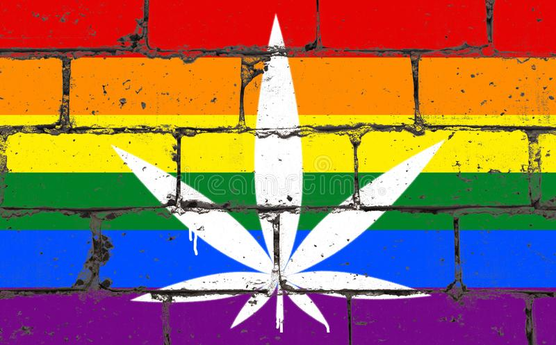 Graffiti street art spray drawing on stencil. Cannabis leaf on brick wall with flag LGBT community stock images