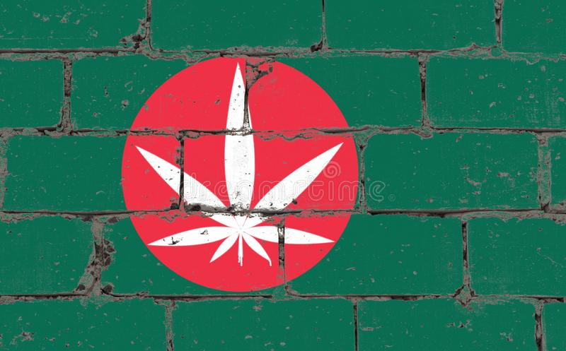 Graffiti street art spray drawing on stencil. Cannabis white leaf on brick wall with flag Bangladesh stock images