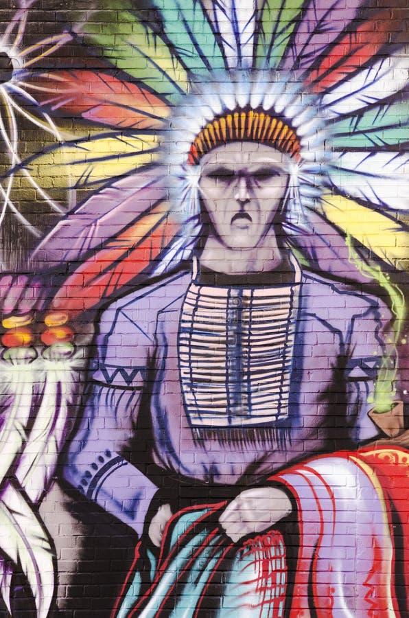 Graffiti sur le mur de briques avec l'Indien photographie stock