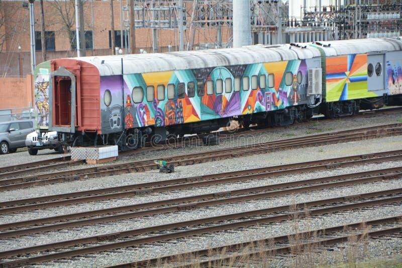 Graffiti on train cars in SE Portland, Oregon. This is graffiti decorating railroad train cars in SE Portland, Oregon`s industrial area stock image