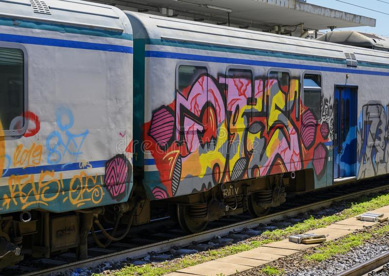 Graffiti on a train in the trainstation in Camogli, Northern Italy royalty free stock photos