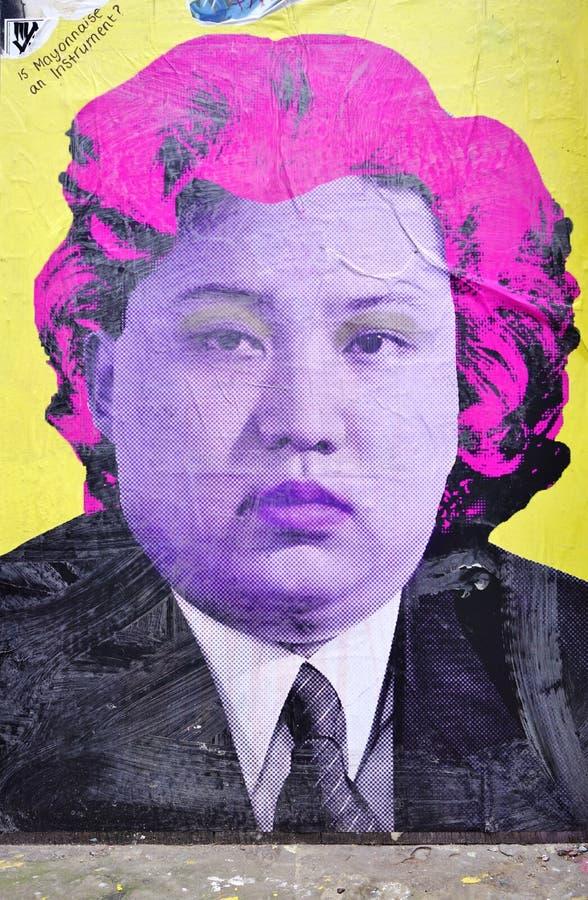 Graffiti uliczna sztuka reprezentuje Kim UN w Ceglanym pasa ruchu brzeg przykopu sąsiedztwie Londyn obrazy stock