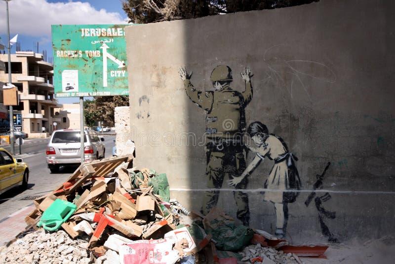 Graffiti van Banksy in Bethlehem, Palestina royalty-vrije stock foto's