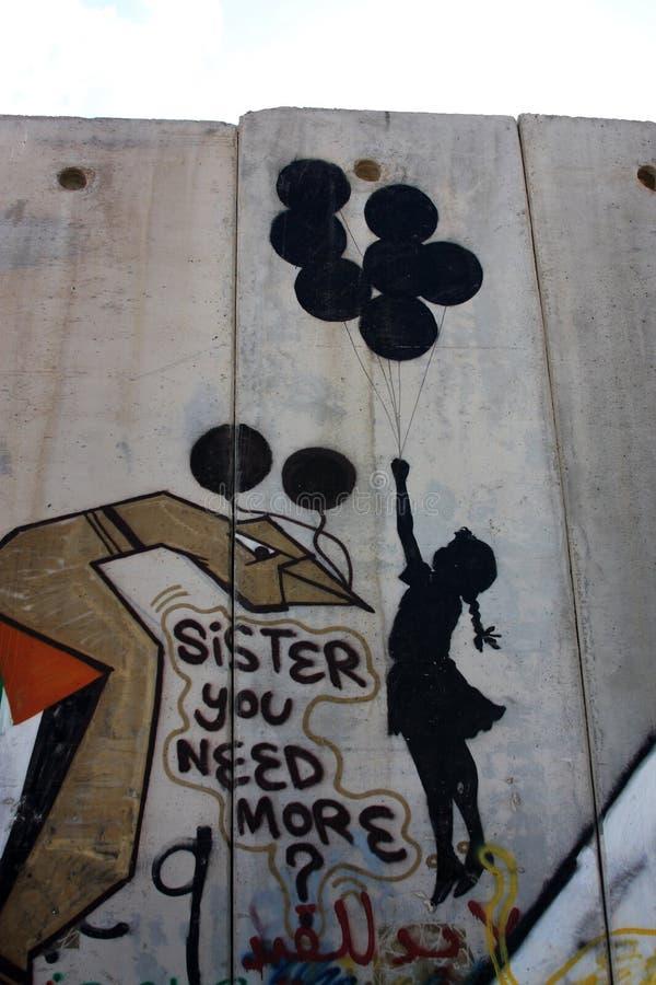 Graffiti van Banksy op de muur van Palestina stock foto's