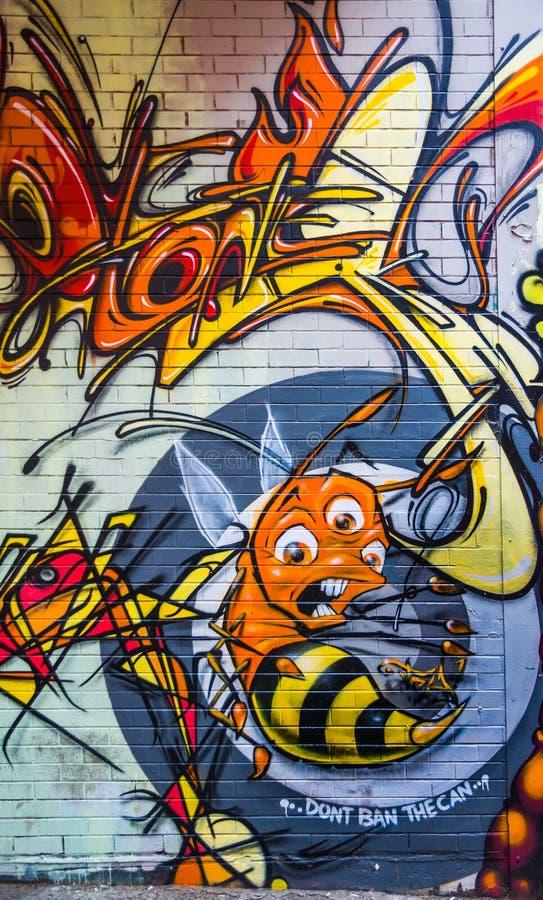 Graffiti von verängstigter Biene mit 3 Augen, Melbourne, Australien lizenzfreies stockbild