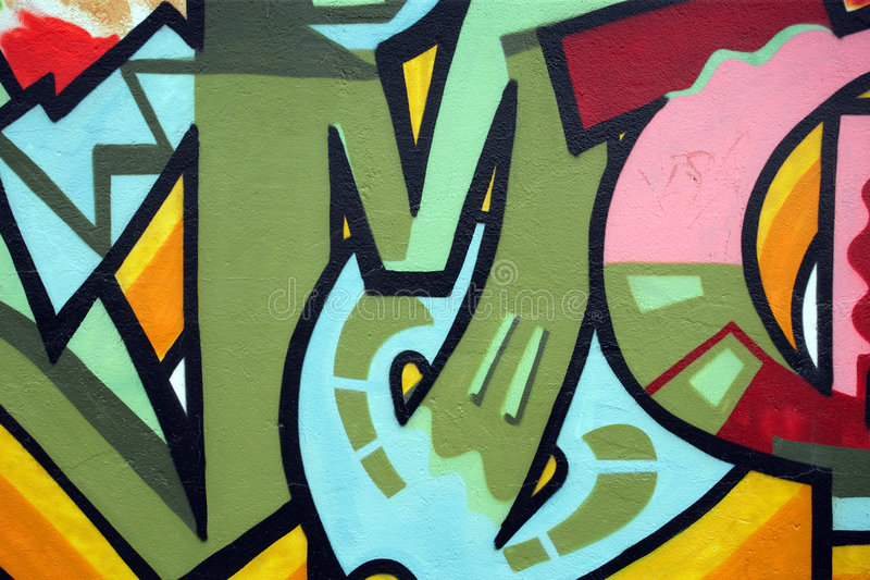 Graffiti wall. Illegal graffiti vandalism in a back alley stock photography