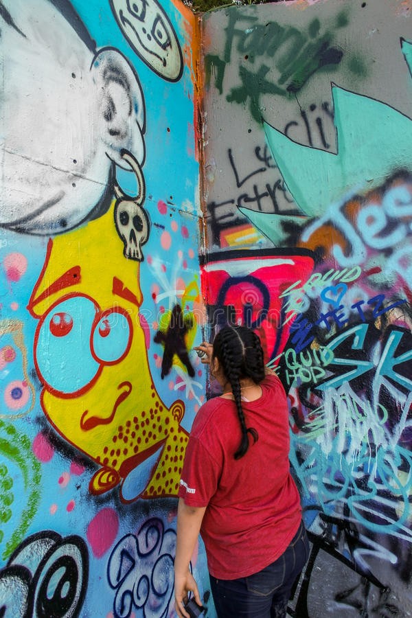 Graffiti Wall and Artist. Austin Texas. Graffiti Artist at Hope Outdoor Gallery in Austin Texas. An open call to paint freely in an urban artists friendly way royalty free stock photography