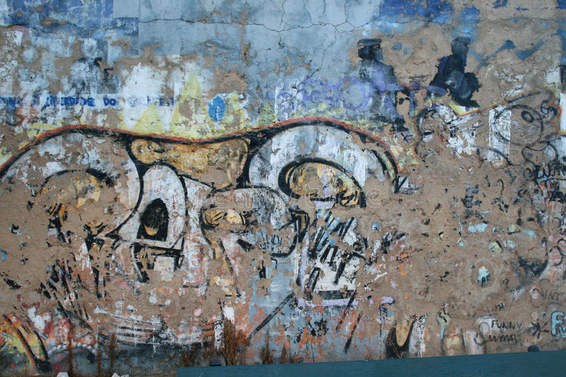 Graffiti Wall Background. Grungy and Scratched Graffiti Wall Background stock photo