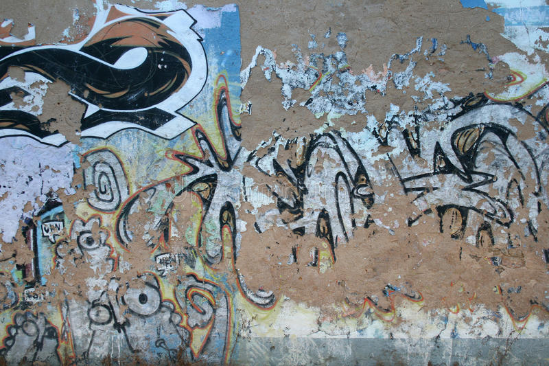 Graffiti Wall Background. Grungy and Scratched Graffiti Wall Background stock photos