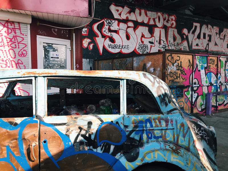 Graffiti wall background. Urban street art. On abandoned old car royalty free stock images