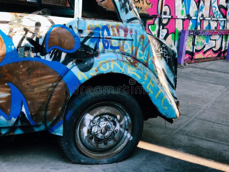 Graffiti wall background. Urban street art. On abandoned old car stock image