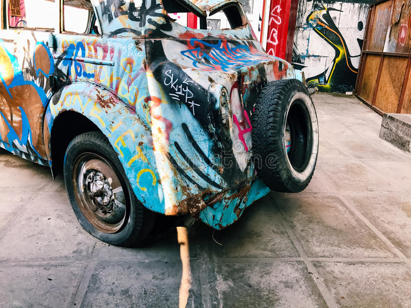 Graffiti wall background. Urban street art. On abandoned old car stock images