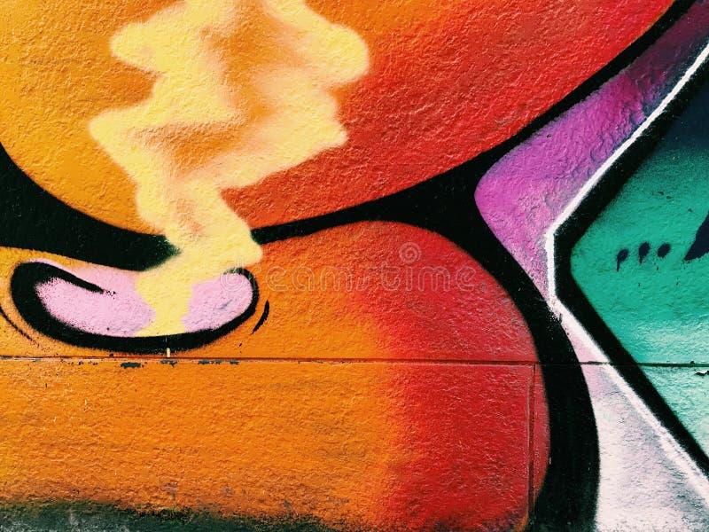 Graffiti wall background. Urban street art. Design royalty free stock photo