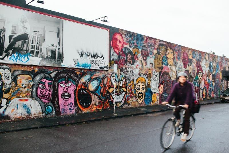 Graffiti wall of faces.