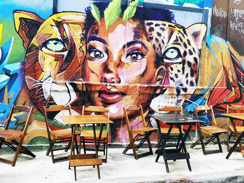Graffiti wall and tables for coffee stock photography