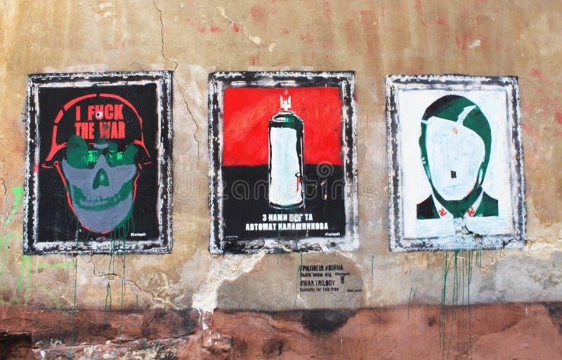 Graffiti. War trilogy by painter Sociopath (Ukrainin Banksy) on an old wall of a medieval building on the corner of Virmenska and Drukarska streets in Lviv stock photo