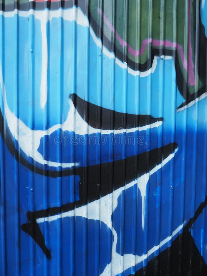 Graffitidetails met blauwe dominant stock illustratie