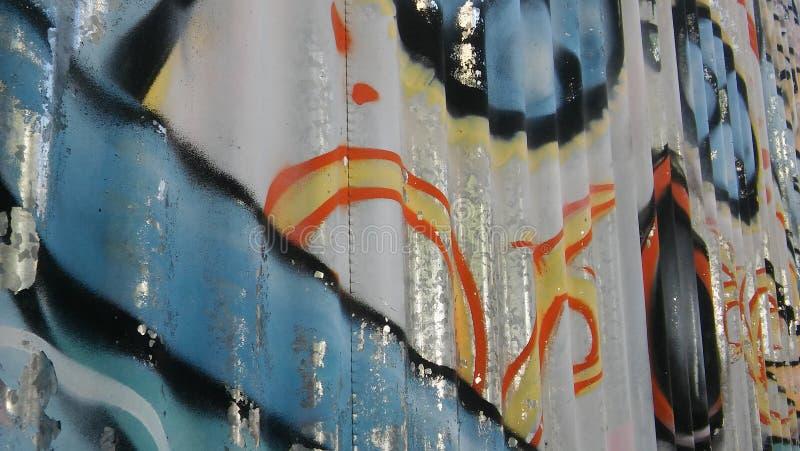 Graffitti på arkjärn arkivfoto