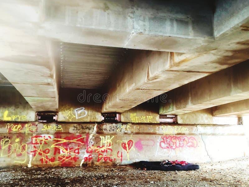 Graffitti under the bridge. Spraypaint, words, color stock photos