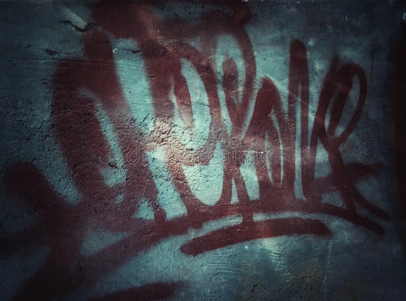 Graffity en la pared del grunge imagen de archivo