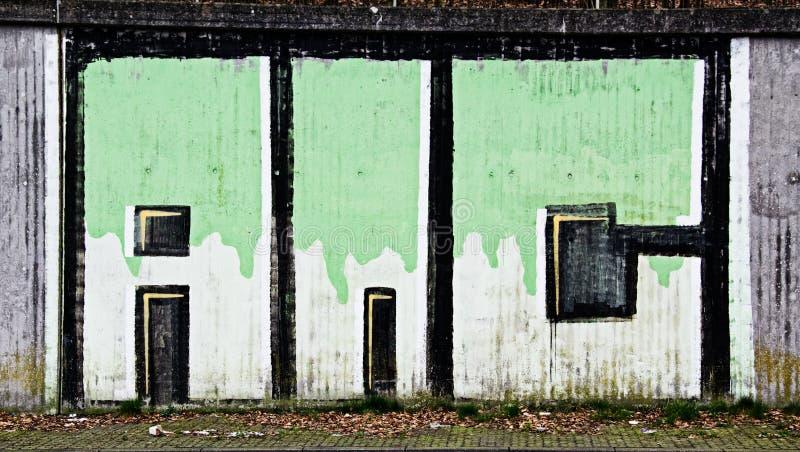 graffity verde en la pared gris en la carretera a45 foto de archivo libre de regalías
