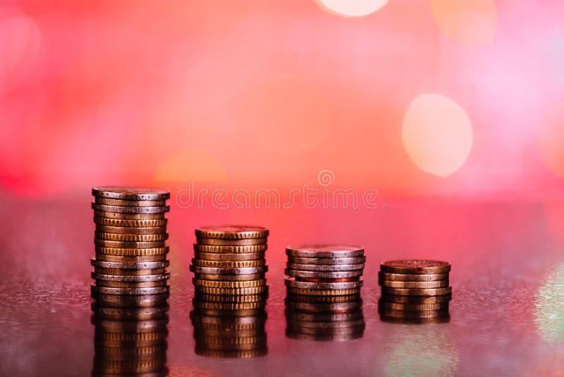 Grafico con le monete: perdite rosse immagine stock libera da diritti