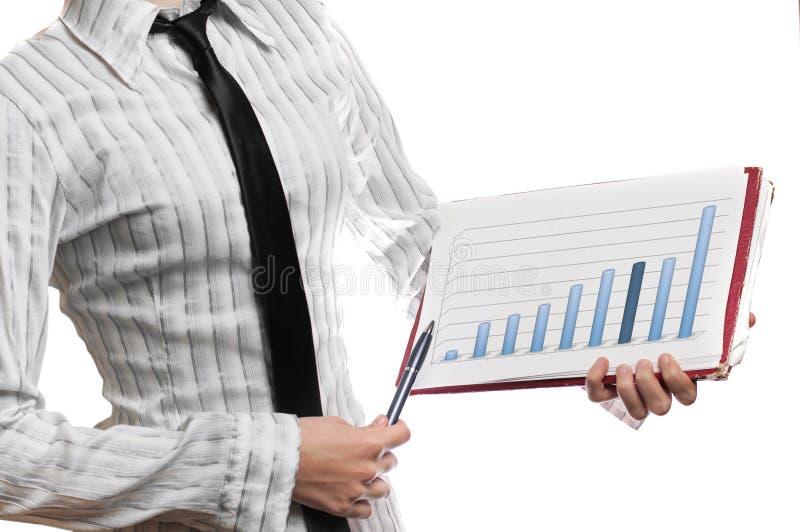 Grafico di statistica della tenuta della donna di affari fotografia stock