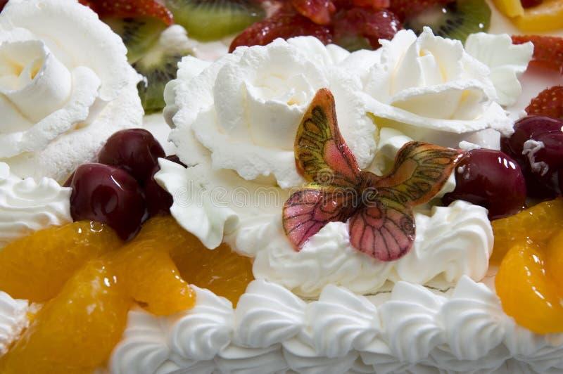 Grafico a torta con la farfalla della glassa fotografia stock