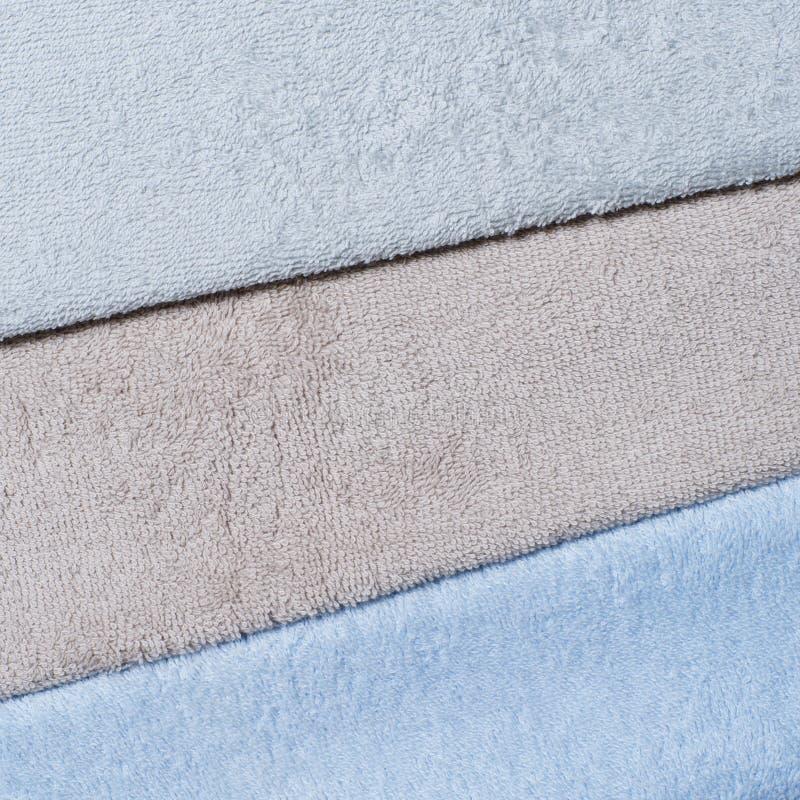 Grafit som är kall som är beige och som är blå, färgen av frottéhanddukar royaltyfri fotografi