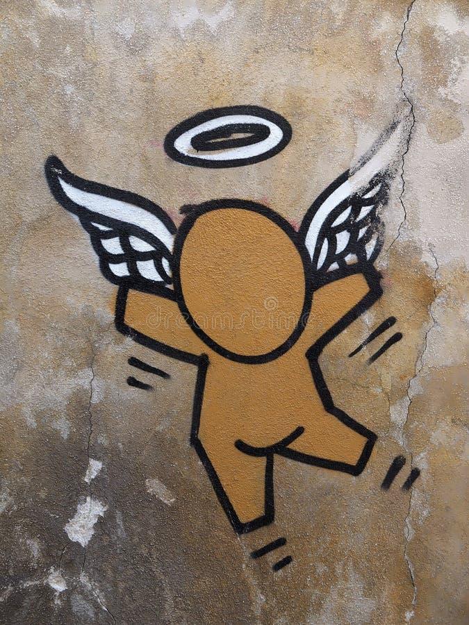 Grafitti av en skyddsängel i Venedig arkivfoton